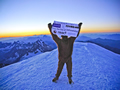 Alex Staniforth on the summit of Mont Blanc at 6:00am on Thursday 26th July, wearing an orangutan suit to show his support for REACT. Click for bigger image.