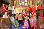 The congregation of 12th June 2011, dressed in 'flame colours' in celebration of Pentecost.
