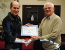 Presentation of 'Best Community Website' award to John Hammond by Parish Chairman Terry Harrop. Click for bigger image.